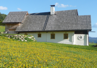 The 300 year old traditional wooden blockhouse in Carinthia is a protected monument (view: North side)