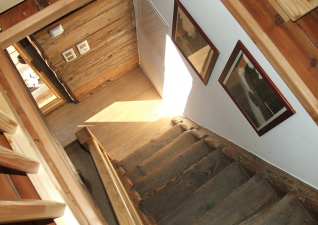 Stairway: The cottage is small but powerful. For decades, it served as a depository of valuable food.