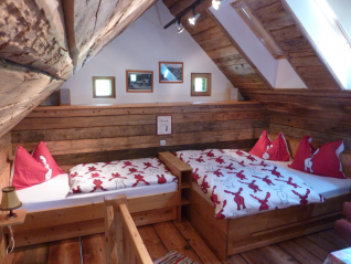 The bedroom on the first floor can accommodate up to five people. Also a cot can be placed there.